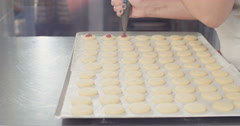 Tracking shot of Strawberry jam piping on butter cookies - stock footage