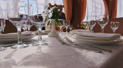 On the table are wine glasses, plates and cutlery. There is no one, the sun - stock footage