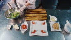 Chef preparing salad Caesar, in the frame only hands visible - stock footage