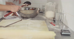 Preparation of plum filled strudel in a bekary Stock Footage