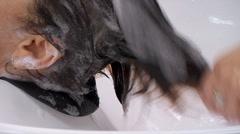 Washing Of The Dark Female Hair Stock Footage