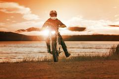 Man riding enduro motorcycle in motor cross track use for people activities a Stock Photos