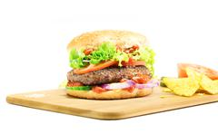 Hamburger - homemade burger with fresh vegetables - stock photo