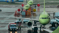 Infrastructure International Airport. Planes at the site, the staff make the Stock Footage