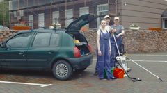 Three cleaners standing near the car. Stock Footage