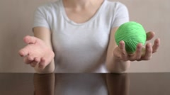 Woman throwing a clew from hand to hand Stock Footage