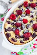Homemade casserole with cottage cheese, semolina and raspberries, vertical - stock photo