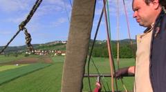Hot air ballooning pilot - stock footage