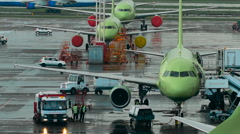 Infrastructure International Airport. Planes at the site, the staff make the - stock footage