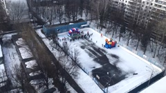 Children and Their Parents at the Maslenitsa on a Hockey Field in a Courtyard. Stock Footage