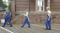 Cleaners come with their equipment. - stock footage