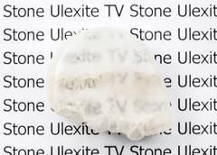 polished Ulexite (TV stone) mineral gemstone - stock photo