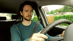 Sad handsome man almost crying driving car thinking about lost love 4K Stock Footage