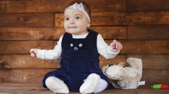 Little baby girl playing with plush toys Stock Footage