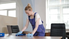 Cleaning lady tries to scrub the dirt. - stock footage