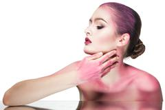 Topless woman in pink glitter Stock Photos