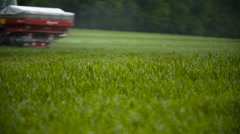 Wheat field and tractor plowing Stock Footage