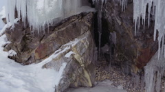 Grottoes and cracks in the rock with icicles Stock Footage