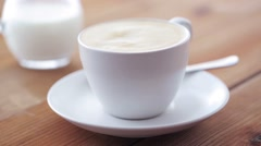 Coffee and sugar falling to cup on table Stock Footage