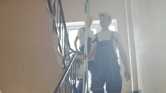 Cleaners down the stairs. Stock Footage