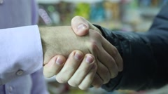 Two business partner shake hands when meeting. Stock Footage