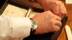 Male hands closeup glue leather items. - stock footage