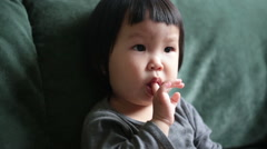 Face of a toddler concentrating on watching online music video. - stock footage