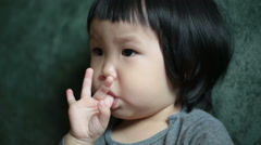 Face of a toddlerconcentrating on watching online music video. - stock footage