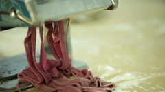 Woman using a pasta maker to make pasta with purple beet color Stock Footage