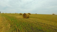 Aerial View of Field with Haystacks Stock Footage