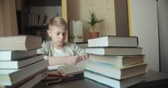Child writes homework. Dolly shot Stock Footage
