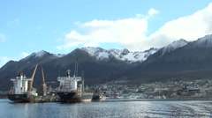 Boats on the Beagle Channel with the city, snowy mountains in the background Stock Footage