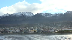 City far behind the Beagle Channel with snowy mountains background Stock Footage