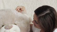Girl with a soft toy - stock footage