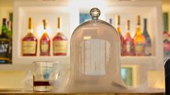 Guatemalan rum under a glass dome - stock photo