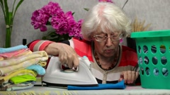 Old woman check iron Stock Footage