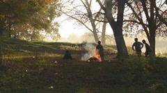Children jump over fire Stock Footage