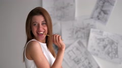 Beautiful woman flirting with camera with pencil - stock footage