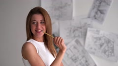 business woman flirting with camera with pencil - stock footage