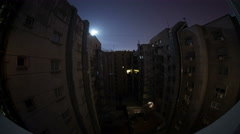 Moon over residential apartment interior industrial night to day time Spain 4k Stock Footage