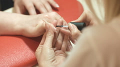 Manicure. Nail Polish. Woman in a Beauty Salon receiving a manicure by a Stock Footage