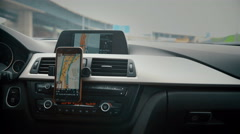 Close up on screen navigation tracking vehicle location and route while driving Stock Footage