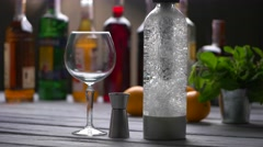Empty wineglass beside bottle. - stock footage
