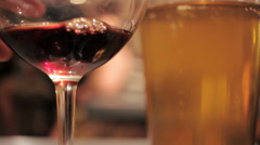 Woman Drinks a Glass of Red Wine in a Crowded Pub. - stock footage