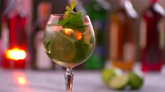 Rotating glass filled with drink. Stock Footage