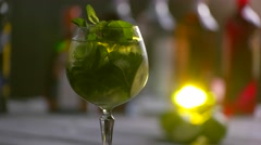 Glass of cocktail is rotating. Stock Footage
