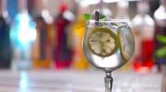 Glass of drink slowly rotates. Stock Footage
