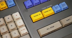An Editor Presses Mark In and Mark Out Buttons on an Edit Controller - stock footage