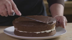 Spreading ganache over a chocolate cake Stock Footage