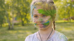 Happy girl on the festival of colors Holi Stock Footage